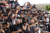 Photographers take pictures at the photo call for Jodie Foster. Foster will receive an honorary Palme d'Or during the opening ceremony of the 74th international film festival, Cannes, southern France, Tuesday, July 6, 2021. (AP Photo/Brynn Anderson)