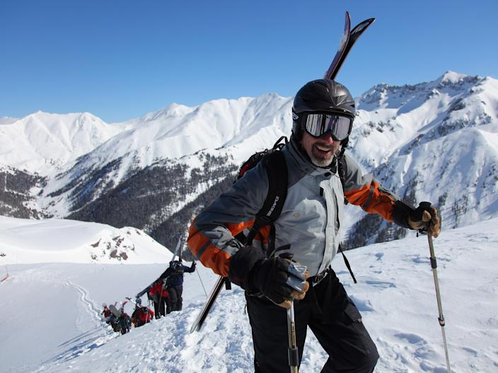 Hiking up a snowy mountain skiing