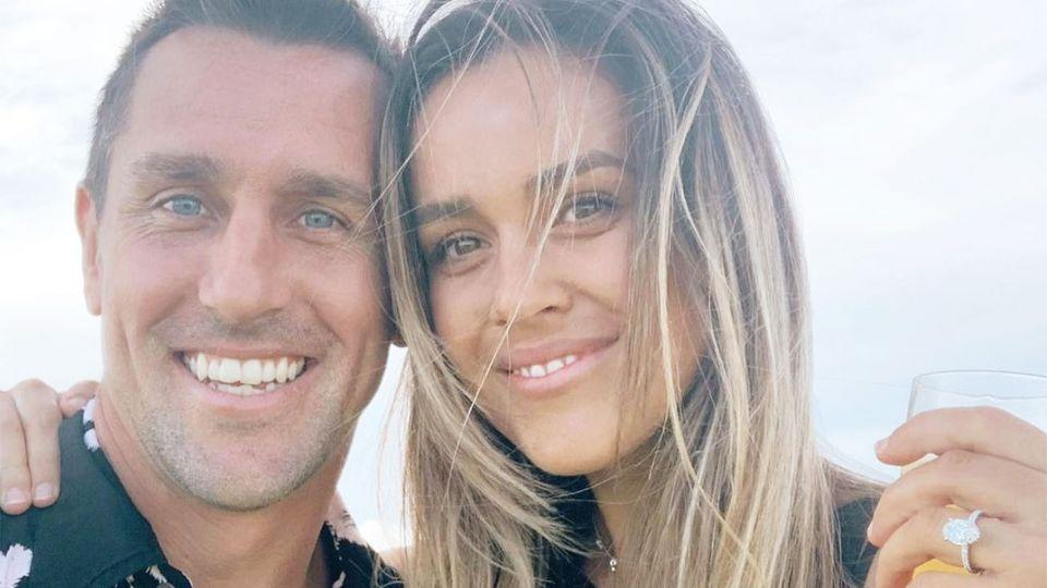 Mitchell Pearce and fiancee Kristen Scott pose together for a photo before the scandal broke.