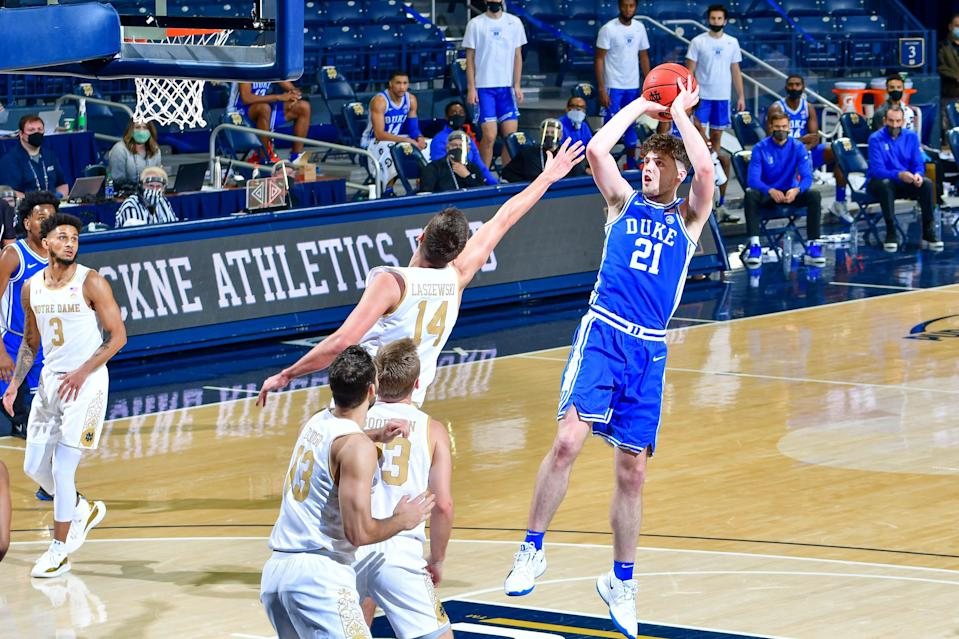 Dec 16, 2020; South Bend, Indiana, USA; Duke Blue Devils forward Matthew Hurt (21) shoots over Notre Dame Fighting Irish forward Nate Laszewski (14) in the first half at the Purcell Pavilion.