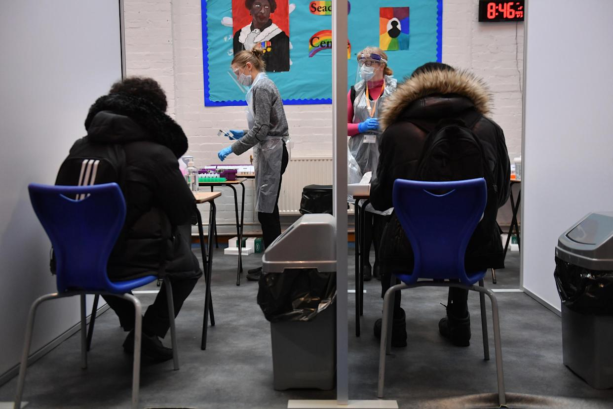 Students take Lateral Flow Tests for coronavirus at the Jewellery Quarter Academy in Birmingham in the West Midlands, as pupils in England return to school for the first time in two months as part of the first stage of lockdown easing. Picture date: Monday March 8, 2021.