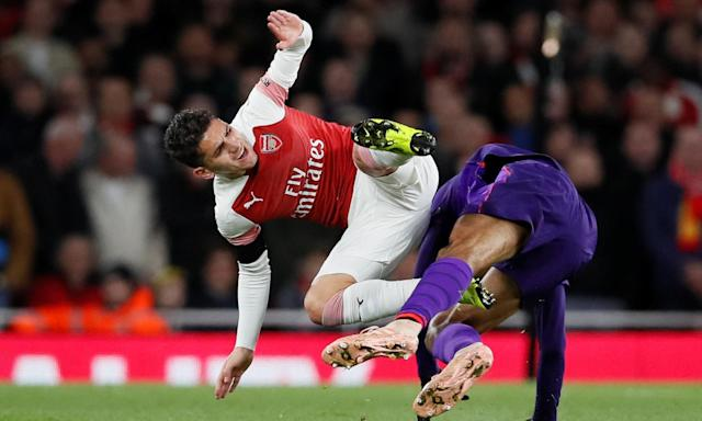 Lucas Torreira tangles with Fabinho. 'Two home fans stood up and spontaneously hugged. Vigour, energy, persistence, grit. What a change to see all of these things.'