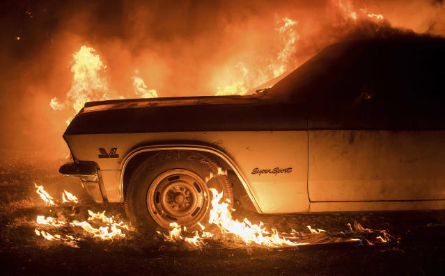 <p>CORRECTS TO JULY FROM JUNE – Flames from a wildfire consume a car near Oroville, Calif., on Saturday, July 8, 2017. Evening winds drove the fire through several neighborhoods leveling homes in its path. (AP Photo/Noah Berger) </p>
