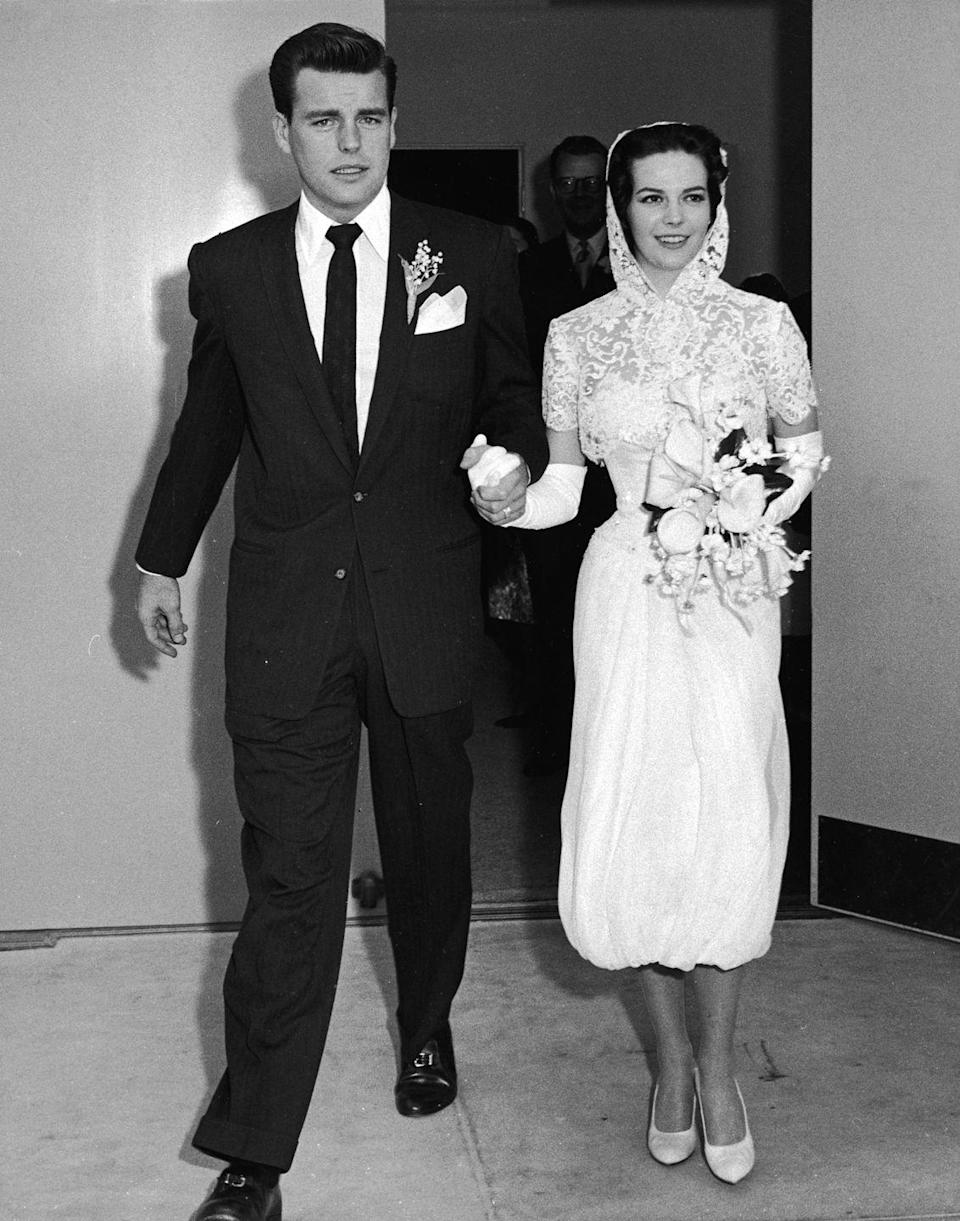 <p>For her first marriage to Robert Wagner in 1957 (the two would remarry in 1972), Natalie Wood opted for a modern look that included a white strapless cocktail dress, a lace hood, and ballet flats. </p>