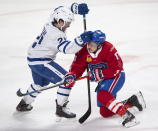 Laval Rocket's Brendan Gallagher, right, is checked by Toronto Marlies' Joseph Duszak during first-period American Hockey League action in Montreal, Monday, May 17, 2021. Carey Price and Gallagher are on a one-game conditioning loan to the Rocket before their playoff series against the Toronto Maple Leafs. (Ryan Remiorz/The Canadian Press via AP)