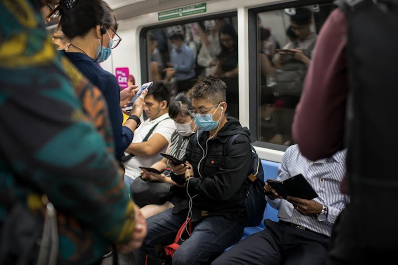 SINGAPORE - 2020/02/17: People wearing protective face masks on the train in Singapore. Singapore declared the COVID-19 outbreak as Code Orange on February 7, 2020 following the corona virus threat. (Photo by Maverick Asio/SOPA Images/LightRocket via Getty Images)