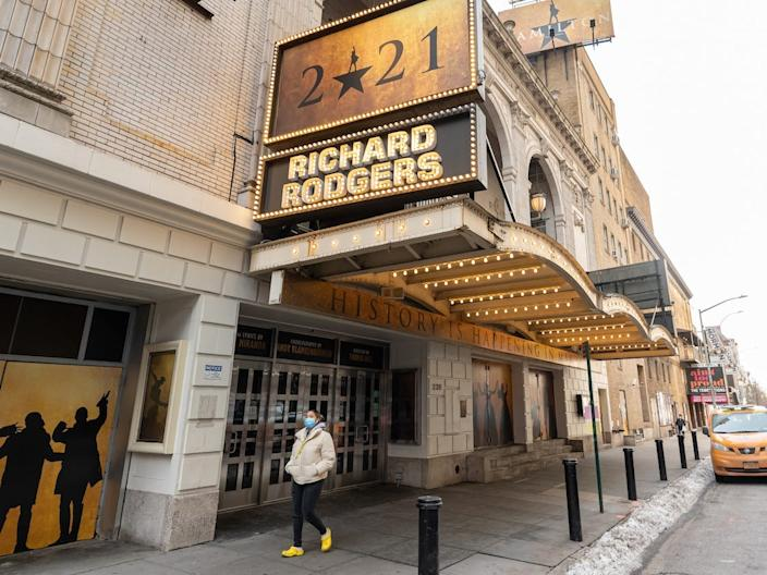 A person walks outside Hamilton at Richard Rodgers Theatre in Times Square in December.