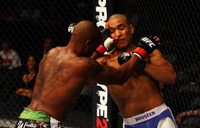 Marcus Brimage (L) and Maximo Blanco exchange blows during their featherweight bout for UFC 145 at Philips Arena on April 21, 2012 in Atlanta, Georgia.