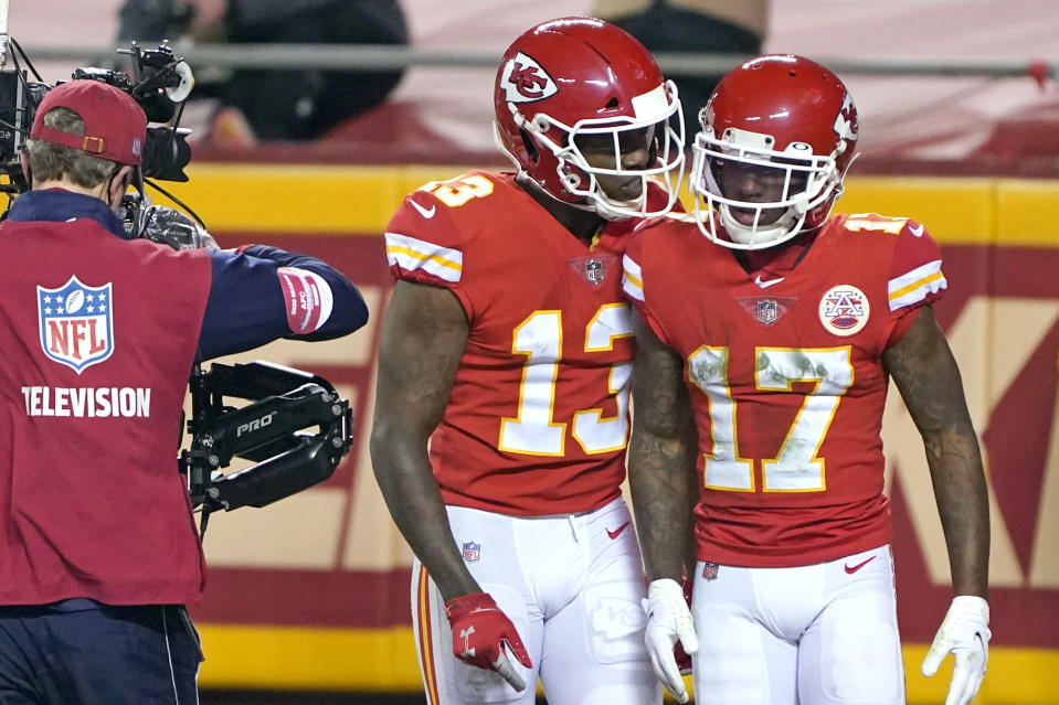 Kansas City Chiefs wide receiver Mecole Hardman (17) celebrates with teammate Byron Pringle (13) after catching a 3-yard touchdown pass during the first half of the AFC championship NFL football game against the Buffalo Bills, Sunday, Jan. 24, 2021, in Kansas City, Mo. (AP Photo/Orlin Wagner)