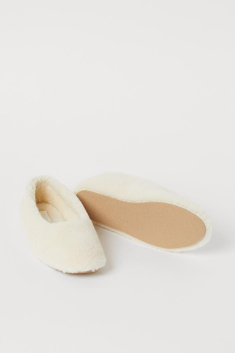 <p>You'll never leave the house once you put on these <span>Faux Shearling Indoor Slippers</span> ($18).</p>