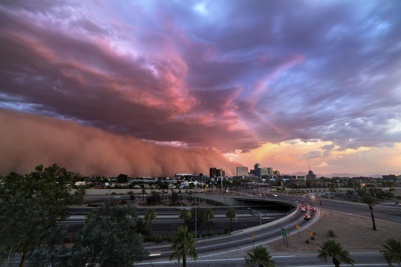<p>A gorgeous dust storm and low level clouds roll into downtown Phoenix on July 3, 2014. (Photo: Mike Olbinski/Caters News) </p>