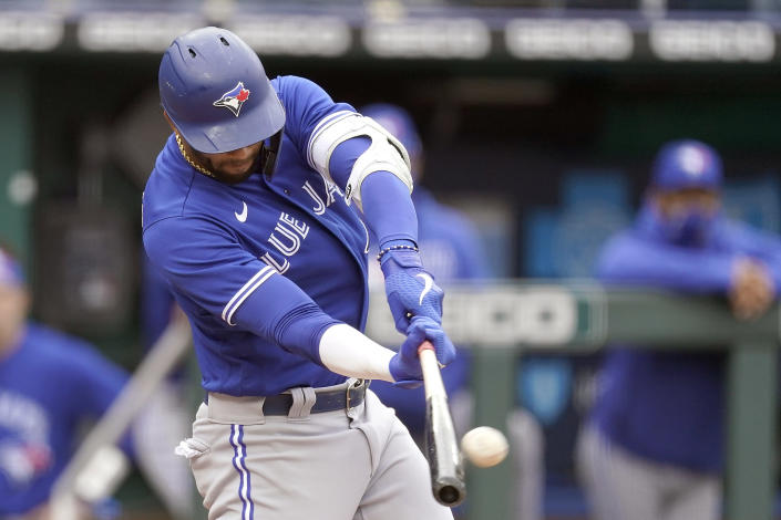 Toronto Blue Jays' Lourdes Gurriel Jr. hits a two-run double during the first inning against the Kansas City Royals in the first baseball game of a doubleheader, Saturday, April 17, 2021, in Kansas City, Mo. (AP Photo/Charlie Riedel)