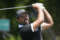 Charl Schwartzel, of South Africa, hits off the third tee during the final round of the PGA Zurich Classic golf tournament at TPC Louisiana in Avondale, La., Sunday, April 25, 2021. (AP Photo/Gerald Herbert)