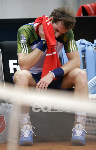 Britain's Andy Murray wipes his face during a pause of a match with Spain's Marcel Granollers during their match at the Italian Open tennis tournament in Rome, Wednesday, May 15, 2013. Murray has retired from his second-round match with Marcel Granollers in the second round of the Italian Open. (AP Photo/Andrew Medichini)
