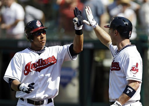 Cleveland Indians' Michael Brantley, left, is greeted by Jack Hannahan after Brantley's three-run home run off Los Angeles Angels starting pitcher Ervin Santana in the first inning of a baseball game, Wednesday, July 4, 2012, in Cleveland. (AP Photo/Mark Duncan)