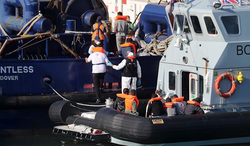A Border Force vessel brings a group of men thought to be migrants into Dover, Kent. (Photo: Gareth Fuller - PA Images via Getty Images)