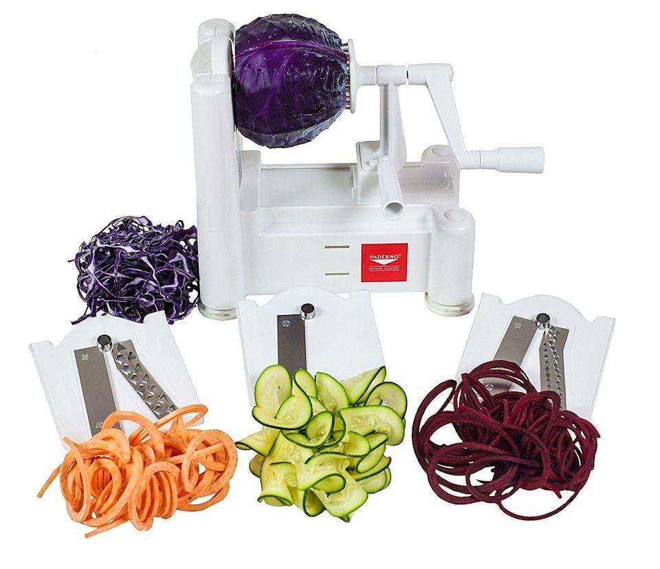 """<p>Spiralizing might be one of those trends your kids will make fun of you for following years from now, but in 2017, no kitchen is complete without the gadget. This one has three interchangeable blades for different noodles.</p><p><strong><em>BUY IT NOW: Paderno World Cuisine Spiral Vegetable Slicer, $25; </em></strong><a href=""""https://www.amazon.com/Paderno-World-Cuisine-Countertop-Mounted-Spiralizer/dp/B0007Y9WHQ/ref=sr_1_2?s=home-garden&ie=UTF8&qid=1506960451&sr=1-2&keywords=spiralizer%2Bpaderno&th=1&tag=syn-yahoo-20&ascsubtag=%5Bartid%7C10063.g.35536497%5Bsrc%7Cyahoo-us"""" rel=""""nofollow noopener"""" target=""""_blank"""" data-ylk=""""slk:Amazon.com"""" class=""""link rapid-noclick-resp""""><strong><em>Amazon.com</em></strong></a></p>"""