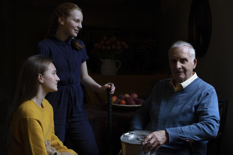 Steven Frank BEM alongside his granddaughters Maggie and Trixie Fleet, aged 15 and 13 (The Duchess of Cambridge/PA Wire)