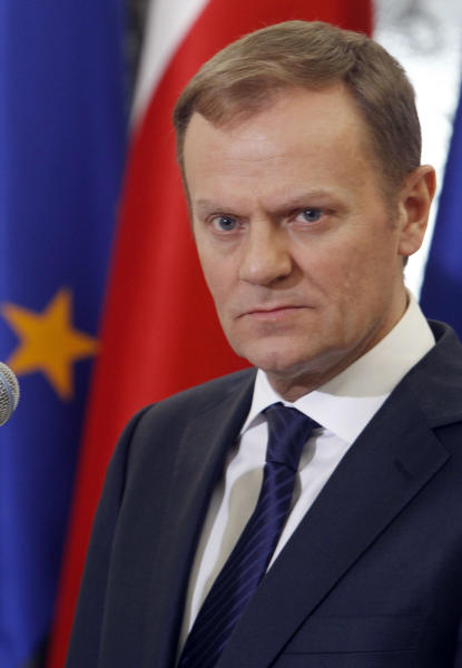 Poland's Prime Minister Donald Tusk announces a compromise on how to overhaul the pension system, in Warsaw, Poland, on Thursday, March 29, 2012. Tusk, with the pro-market Civic Platform party, wanted to raise the retirement age to 67 for all Poles from 60 for women and 65 for men to help bring down state spending. Under the deal reached Thursday with the coalition partner, women will be able to start drawing on retirement payments at 62 and men at 65, but would need to work part time and would get only half their normal pension. (AP Photo/Czarek Sokolowski)