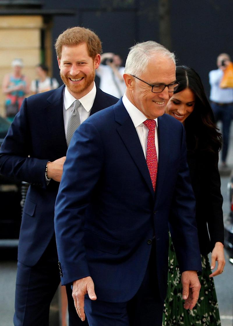 The royal couple share a laugh with the Australian Prime Minister (REUTERS)