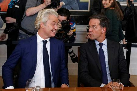 Dutch Prime Minister Rutte talk with Dutch far-right politician Geert Wilders of the PVV Party during a meeting at the House of Representatives in The Hague