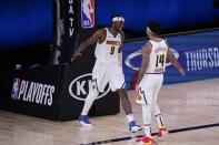 Denver Nuggets forward Jerami Grant (9) and guard Gary Harris (14) celebrate a play during the second half of an NBA conference semifinal playoff basketball game against the Los Angeles Clippers, Tuesday, Sept. 15, 2020, in Lake Buena Vista, Fla. (AP Photo/Mark J. Terrill)