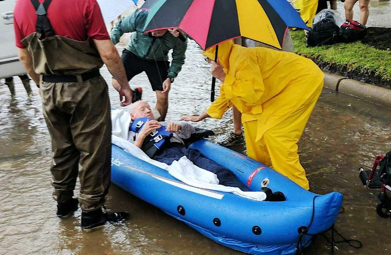 A person is rescued in a Houston neighborhood after water was released to ease overflowing on nearby reservoirs. (Photo: Roque Planas/HuffPost)