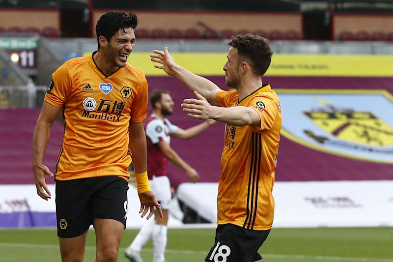 Wolverhampton Wanderers' Mexican striker Raul Jimenez (L) is congratulated by Wolverhampton Wanderers' Portuguese midfielder Diogo Jota after scoring a goal during the English Premier League football match between Burnley and Wolverhampton Wanderers at Turf Moor in Burnley, north-west England on July 15, 2020. (Photo by JASON CAIRNDUFF / POOL / AFP) / RESTRICTED TO EDITORIAL USE. No use with unauthorized audio, video, data, fixture lists, club/league logos or 'live' services. Online in-match use limited to 120 images. An additional 40 images may be used in extra time. No video emulation. Social media in-match use limited to 120 images. An additional 40 images may be used in extra time. No use in betting publications, games or single club/league/player publications. / (Photo by JASON CAIRNDUFF/POOL/AFP via Getty Images)
