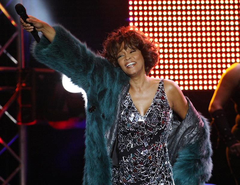 MOSCOW - DECEMBER 9: Singer Whitney Houston performs on stage at Olympisky Sports Complex on December 9, 2009 in Moscow, Russia. Moscow is the first city in her world-wide 2009-2010 tour. (Photo by Epsilon/Getty Images)