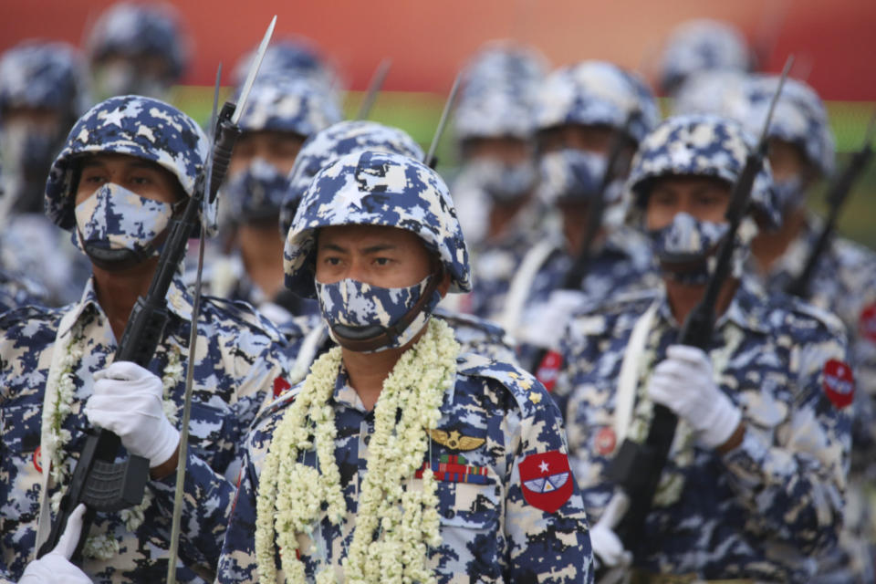 Military personnel participate in a parade on Armed Forces Day in Naypyitaw, Myanmar, Saturday, March 27, 2021. Military personnel participate in a parade on Armed Forces Day in Naypyitaw, Myanmar, Saturday, March 27, 2021. Senior Gen. Min Aung Hlaing, the head of Myanmar's junta, on Saturday used the occasion of the country's Armed Forces Day to try to justify the overthrow of the elected government of Aung San Suu Kyi, as protesters marked the holiday by calling for even bigger demonstrations. (AP Photo) (AP Photo)