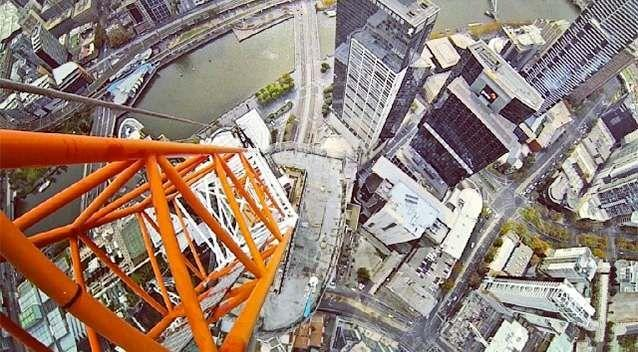 Don't look down! Daredevil Bryce Wilson snaps a picture on top of scaffolding 240 metres above Melbourne. Photo: Bryce Wilson/Instagram