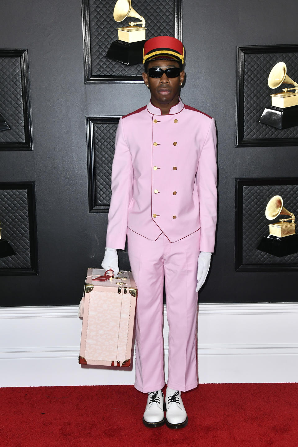 """The rapper wore a bell hop inspired suit from his own fashion line, Golf Wang. The 28-year-old Best Rap Album winner's quirky """"Grand Budapest Hotel"""" meets Grammys ensemble stood out in all the right ways."""