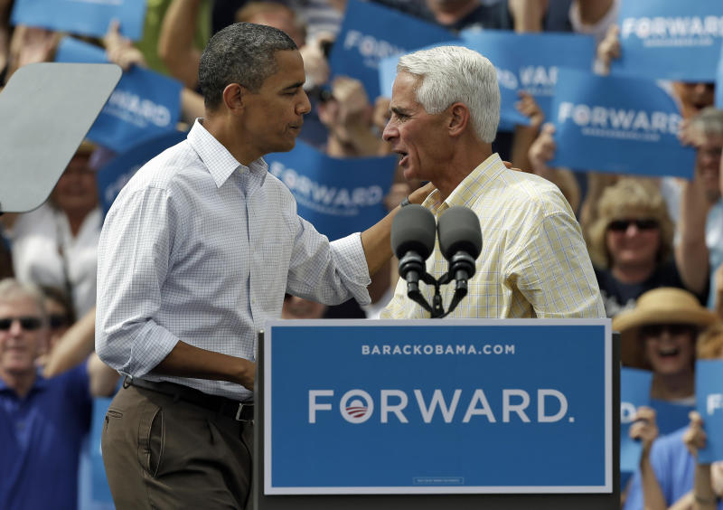 FILE - In this Saturday, Sept. 8, 2012 file photo, President Obama, left, talks with former Florida Gov. Charlie Crist at a campaign rally in Seminole, Fla. The man who once identified himself as a Ronald Reagan Republican is gearing up for another gubernatorial bid as a Barack Obama Democrat. (AP Photo/Chris O'Meara, File)