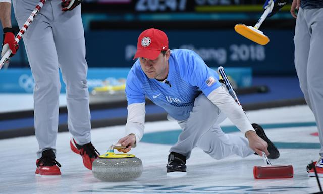 USA's John Shuster strows the stone during Saturday's men's curling gold medal match against Sweden.