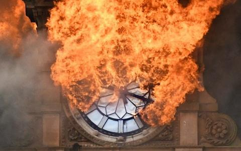 The moment Belfast lost the iconic landmark clock on one of the city's most historic buildings as it was ravaged by fire in August - Credit: Alan Lewis-Photopress Belfast