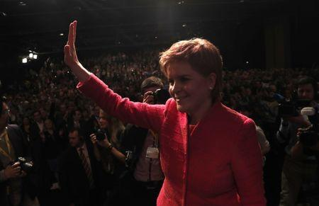 Party leader Nicola Sturgeon waves after speaking at the Scottish National Party's conference in Aberdeen, Scotland