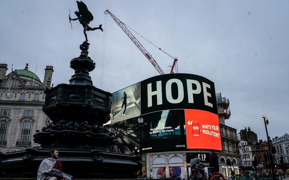 Jeff Moore's famous piccadilly circus displays a message from HSBC bank using the word hope. - Jeff Moore