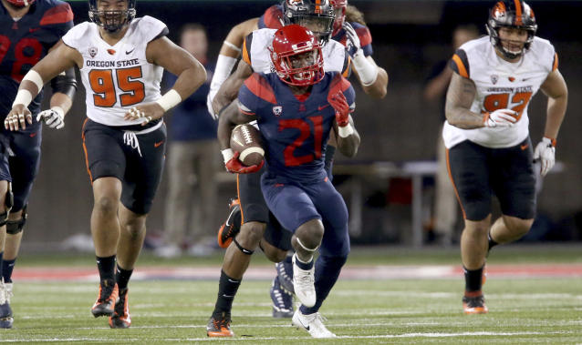 Arizona running back J.J. Taylor (21) leaves the Oregon State defense behind on a long run during the second quarter of an NCAA college football game Saturday, Nov. 11, 2017, Tucson, Ariz. (Kelly Presnell/Arizona Daily Star via AP)