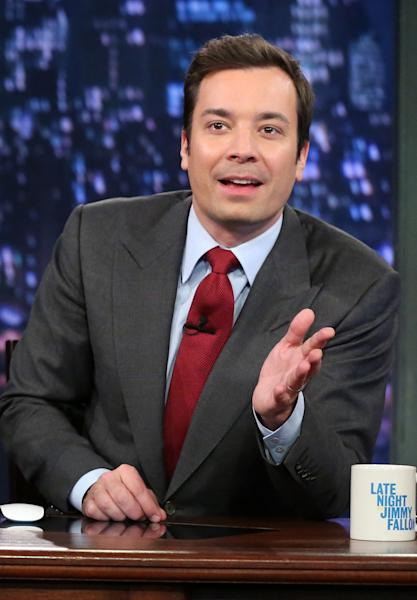 "This Feb. 1, 2013 photo released by NBC shows Jimmy Fallon, host of ""Late Night with Jimmy Fallon,"" on the set in New York. (AP Photo/NBC, Lloyd Bishop)"