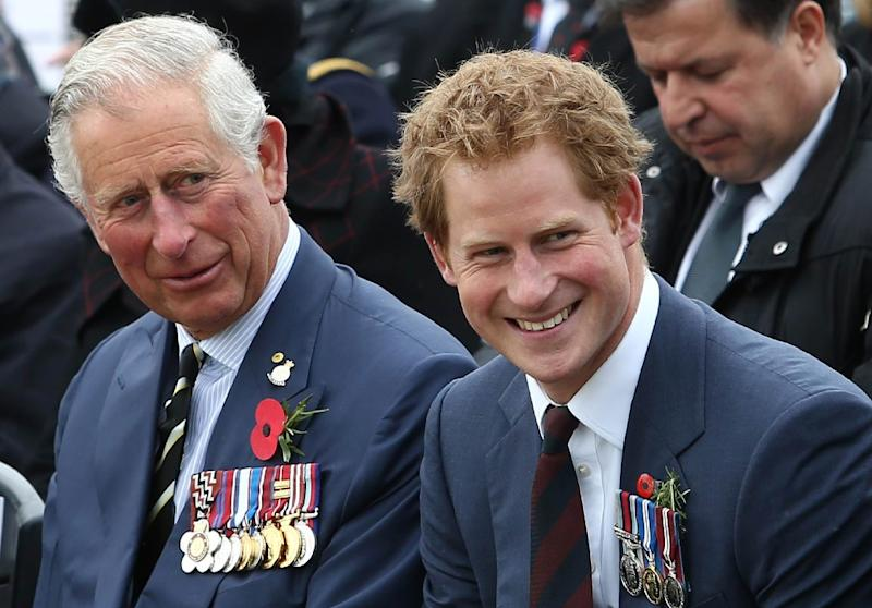 Britain's Prince Charles (L) and Prince Harry are pictured on April 25, 2015