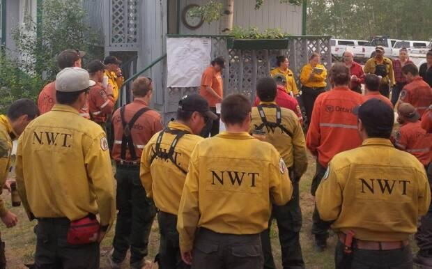 Firefighters from the N.W.T., Ontario and Wood Buffalo National Park attend a briefing near Hay River, N.W.T. in 2015. Part of the reason the territory is staffing up is to prevent the need to fly in more workers from the south if fires grow bigger.
