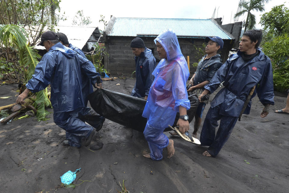 Rescuers carry the body of a man that drowned in floods as Typhoon Goni hit Guinobatan, Albay province, central Philippines, Sunday, Nov. 1, 2020. The super typhoon slammed into the eastern Philippines with ferocious winds early Sunday and about a million people have been evacuated in its projected path, including in the capital where the main international airport was ordered closed. (AP Photo)