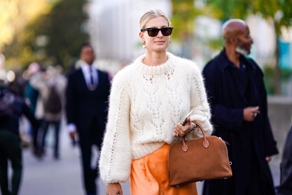 """<p>Sweaters are a <a href=""""https://www.marieclaire.com/fashion/g30900180/fall-fashion-trends-2020/"""" rel=""""nofollow noopener"""" target=""""_blank"""" data-ylk=""""slk:fall/winter staple,"""" class=""""link rapid-noclick-resp"""">fall/winter staple,</a> so adding one (or two) new ones<a href=""""https://www.marieclaire.com/fashion/g2445/chunky-sweaters-fall/"""" rel=""""nofollow noopener"""" target=""""_blank"""" data-ylk=""""slk:to your collection"""" class=""""link rapid-noclick-resp""""> to your collection</a> every season sounds good to me. (Then again, I shop and write about fashion for a living.) If you're searching for a sweater in a new color way or print, I have recommendations up my sleeves. But before we get to the selections, I know you're likely keeping track of your shopping budget for the year. So here's a little secret: You really can find affordable, and adorable, sweaters on Amazon. For less than $50, you can score a cozy knit to wear while you sip your coffee on the weekends or to layer with a turtleneck undershirt for your outdoor adventures. We did our best to find tops with <a href=""""https://www.marieclaire.com/fashion/g29991369/best-embellished-sweaters/"""" rel=""""nofollow noopener"""" target=""""_blank"""" data-ylk=""""slk:an interesting design"""" class=""""link rapid-noclick-resp"""">an interesting design</a> that still feel wearable—and if you want simplicity, we found some everyday basics to boot. The only thing better than scoring an affordable find is receiving said find in 48 hours via Prime.<br></p>"""