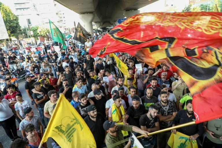 Hundreds of people demonstrated in Beirut's southern suburbs, a Hezbollah stronghold, expressing anger towards the US and support of the judge's decision (AFP Photo/ANWAR AMRO)