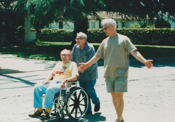 Lionel Friedman (in wheelchair), John Strauss and author Larry Strauss (right) in Los Angeles.
