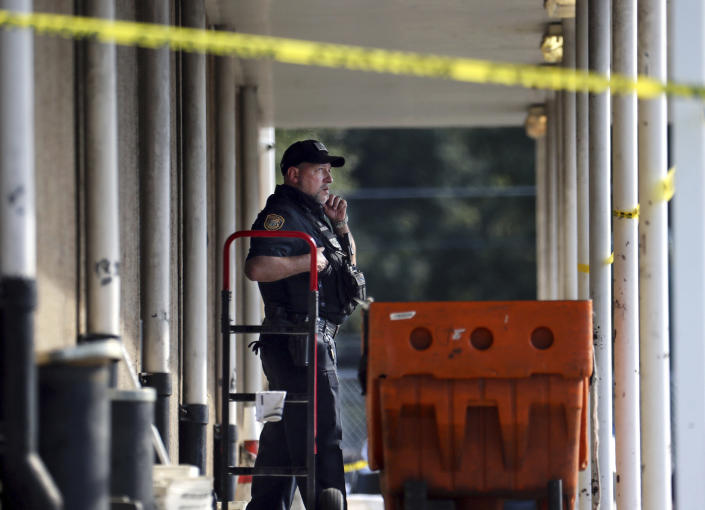 Memphis Police Department officers work the scene of a post office after a shooting, Tuesday, Oct. 12, 2021 in the Orange Mound neighborhood of Memphis, Tenn. Police investigated a shooting Tuesday at a post office in an historic neighborhood of Memphis, Tennessee, the third high-profile shooting in the region in weeks.(Patrick Lantrip/Daily Memphian via AP)