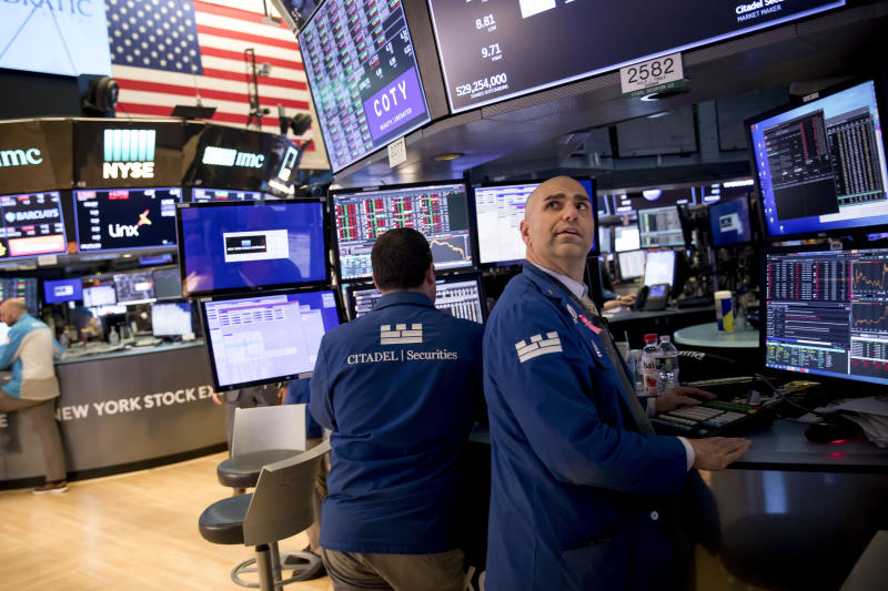 NEW YORK, March 12, 2020 -- Traders work at the New York Stock Exchange in New York, the United States, March 12, 2020. Intensifying coronavirus fears battered Wall Street on Thursday with a historic nosedive in its worst session since the 1987 market crash. The Dow slumped more than 2,300 points, or about 10 percent, at the close, notching its biggest one-day percentage drop since the 1987 Black Monday market crash, when it collapsed by more than 22 percent. (Photo by Xinhua/Xinhua via Getty) (Xinhua/ via Getty Images)