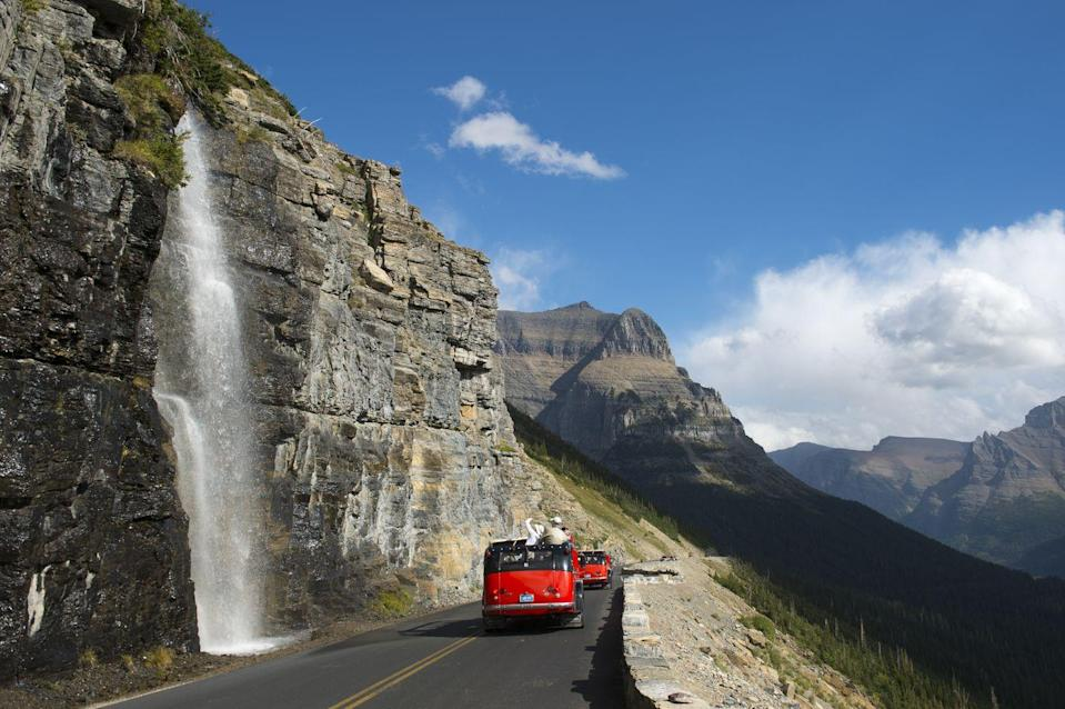 """<p>One of the most picturesque mountain locations in the country deserved a way to be seen by more—or so those behind the 51-mile Going-to-the-Sun Road in <a href=""""https://www.nps.gov/glac/learn/news/upload/Going-to-the-Sun-Road-An-Engineering-Feat.pdf"""" rel=""""nofollow noopener"""" target=""""_blank"""" data-ylk=""""slk:Glacier National Park"""" class=""""link rapid-noclick-resp"""">Glacier National Park</a> thought. The three-decade-long project included surveyors using ropes to dangle off cliffs for measurements and tunnel excavation done by hand. The road officially opened in 1933, crosses the Continental Divide, and reaches an elevation of 6,646 feet.</p>"""