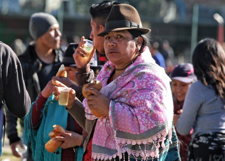 A sharp rise in fuel prices has sent thousands of indigenous, like this woman, into the streets of Ecuador's capitol