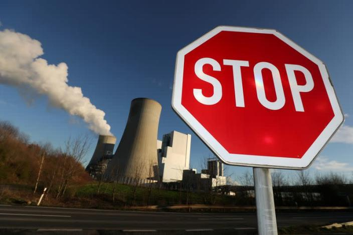 FILE PHOTO: Stop sign stands in front of the Neurath lignite power plant